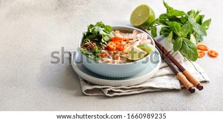 Bun Bo Hue, Bun Bo, Vietnamese beef noodle soup spicy. bowl of beef and rice vermicelli soup, vietnamese noodle cuisine in Hue                               Stok fotoğraf ©