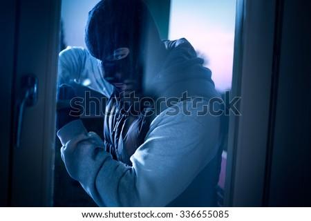 burglar with crowbar to break door to enter the house Stockfoto ©