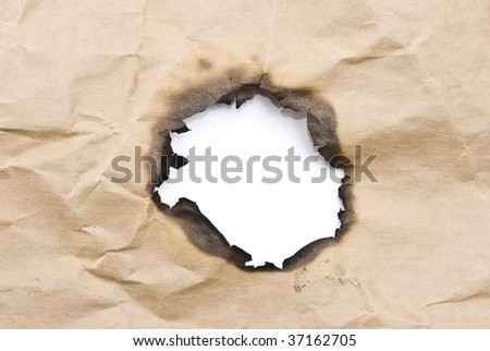 Burnt paper.Hole