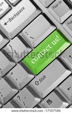"business concept. Keyboard  green key -""contact us"""