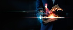 Business growth. Businessman holding tablet and a hot of fire glowing upright arrow with analyzing data and economic growth graph. Strategy. Stock market. Financial and banking. Digital marketing.