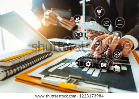 Business team present. professional investor working new start up project. .Digital tablet laptop computer Finance managers meeting with digital marketing media  in virtual icon in morning light  #1223173984