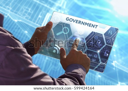 Business, Technology, Internet and network concept . Young business man working on the tablet of the future , select the virtual screen: Government