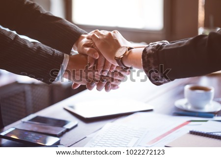 Business trust commitment which Business Partners holding hands with Help, trust ,support ,empathy and factors relationship marketing for reach successful achievement and meeting commit concept.