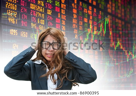 business woman having problems in stock exchange board - stock photo