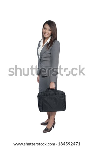 business woman holding a briefcase on white background
