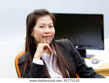 Business woman is working at the office.