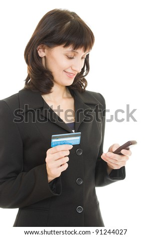 business woman paying with credit card by cellphone, on white background.
