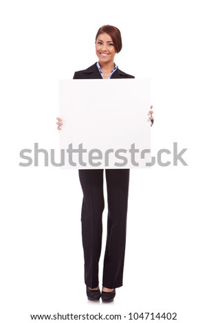 business woman standing behind  a blank board on white background