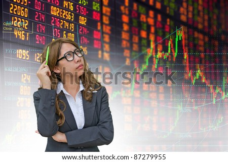 business woman thinking in stock exchange board