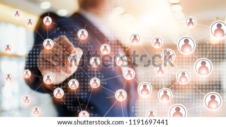 Businessman drawing global structure networking and data exchanges customer connection on office background Foto d'archivio ©