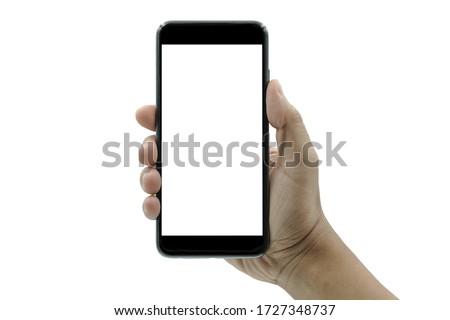 ฺBusinessman hand holding black smartphone isolated on white background, white clipping path inside.