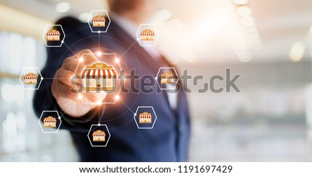 Businessman hand touching icon global network connection on franchise marketing system. Branch of market and customer. Modern technology business.
