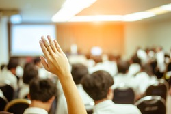 businessman raising hand during seminar. Businessman Raising Hand Up at a Conference to answer a question.