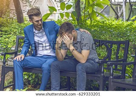 Businessman  Sad Unhappy and  Friend Encouragement  in park