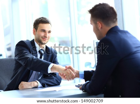 businessman shaking hands to seal a deal with his partner #149002709