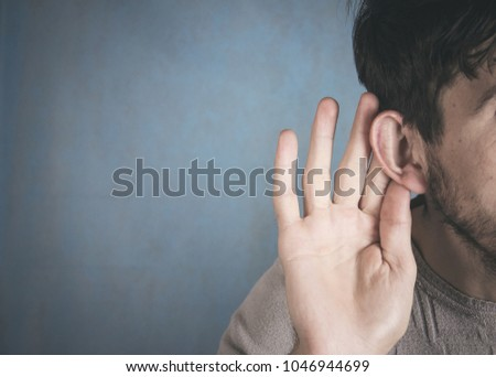 Businessman trying to hear a gossip ストックフォト ©