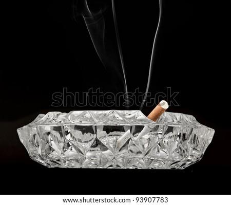 butt cigarette , ashtray  on black background