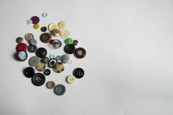 buttons of different colors lay on a white background for all sewing