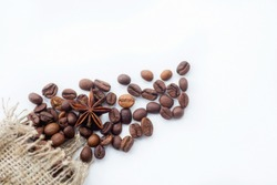 Cafes and restaurants. Natural coffee beans in a bag on a white background, top view. Place for an inscription. The concept of food and hot drinks.