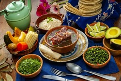 (Caldo de res)  traditional Guatemalan dish served with rice, vegetables, tortillas, and avocado.