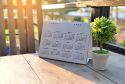 2021 Calendar desk place on the table. Desktop Calender for Planner to plan agenda, timetable, appointment, organization, management each date, month, and year on wooden office table. Calendar Concept