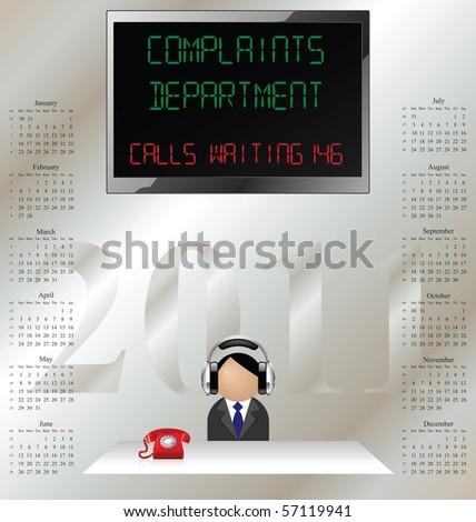 2011 calendar man in customer complaints department wearing ear defenders