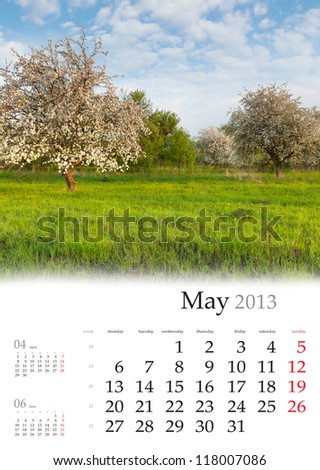 2013 Calendar. May. Beautiful spring landscape in the apples garden.