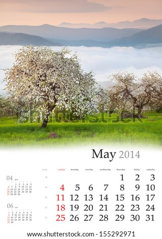 2014 Calendar. May. Blooming apple trees in the mountains in spring
