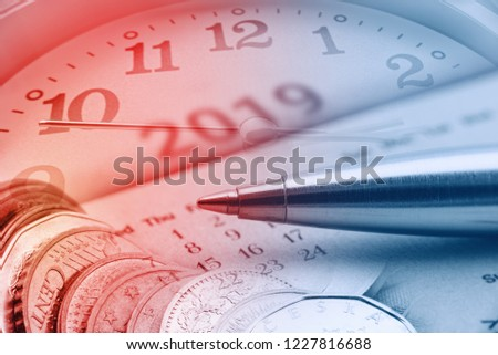 2019 Calendar schedule for long term fund invest / pension saving, financial concept : Pen, clock and coins merged or mixed together, depicts time value of money, investing ways to beat high inflation