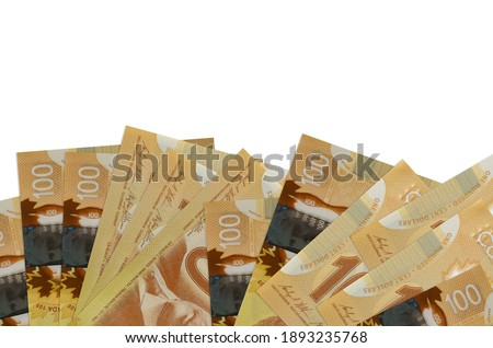100 Canadian dollars bills lies on bottom side of screen isolated on white background with copy space. Background banner template for business concepts with money Photo stock ©