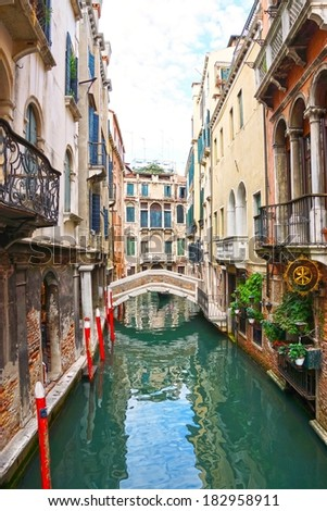 Canal and bridge in Venice, Italy           #182958911