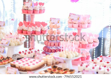Candy bar and wedding cake. Table with sweets, buffet with cupcakes, candies