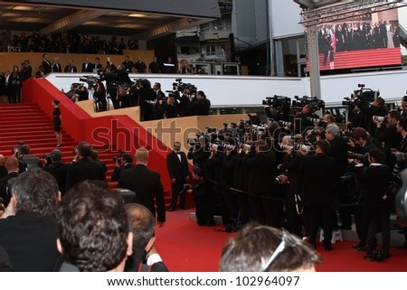 CANNES, FRANCE - MAY 17: Photographers work at 'Of Gods And Men' Premiere at the Palais des Festivals during the 65rd Annual Cannes Film Festival on May 17, 2012 in Cannes, France