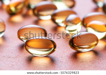 capsules with fats for diet and healthy eating #1076329823