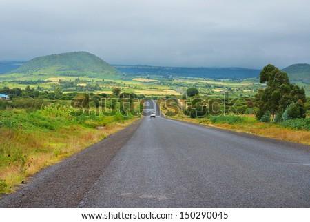 Car on the asphalt road in  Kenya