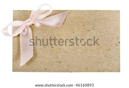 cardboard tags with pink ribbon bow isolated on white background