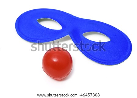 carnival mask and clown nose on a  white background
