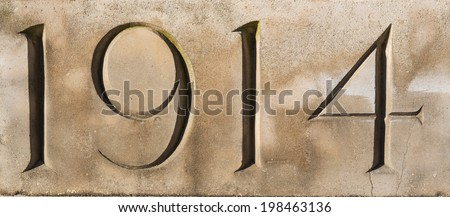 '1914' carved in stone at Tyne Cot War Cemetery, Flanders, Belgium.  Commemorating World War One  Stock photo ©
