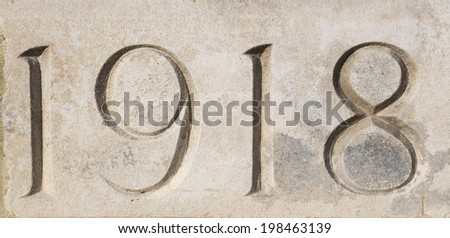 '1918' carved in stone at Tyne Cot War Cemetery, Flanders, Belgium.  Commemorating World War One  Stock photo ©
