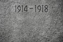 1914-1918 carved on a wall.Number 1914 on monument for the dead of the First World War. stone background texture.