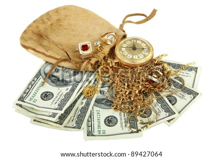 """Cash for gold"" or ""Cash 4 Gold"" a leather pouch filled with gold jewelry lays upon a pile of cash isolated on white with room for your text. represents CASH FOR GOLD business concepts"