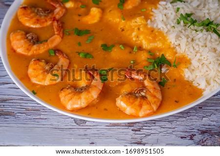 Cassava and shrimp cream served with rice. Typical Brazilian dish called Bobo de camarão Foto stock ©