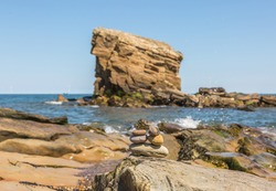 'Charley's Garden' is a sandstone sea stack in Collywell Bay, Seaton Sluice, Northumberland, and as the story goes,  got its name from the person who cultivated the top of it before the sea eventually
