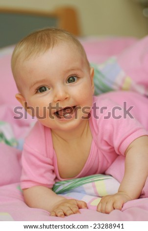 cheerful baby lies on stomach