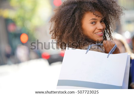 Cheerful girl doing shopping in New York City
