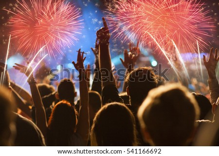 cheering crowd and fireworks - New Year concept #541166692
