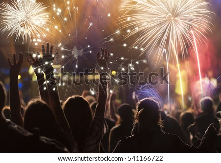 cheering crowd and fireworks - New Year concept #541166722