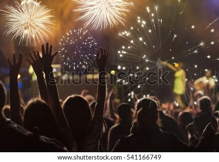 cheering crowd and fireworks - New Year concept #541166749