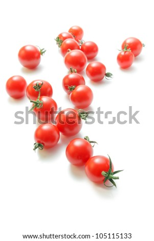 Cherry tomatoes. Fresh ripe cherry tomatoes scattered isolated on white background. - stock photo